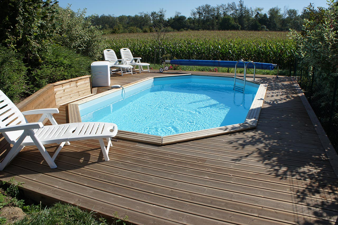 Cr ation d une piscine semi enterr e batiglobal for Construction piscine tva